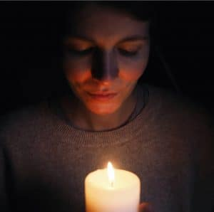 girl with candle in self portrait