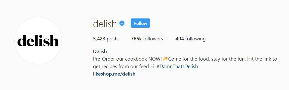 Delish's instagram bio seamlessly weaves together a CTA and their tagline
