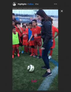Video Screenshot of Lana Del Rey Playing Soccer With A Young Team