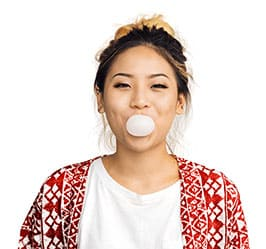 girl blowing a bubble gum