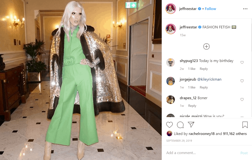 Jeffree Star wearing green jumpsuit and sparkly gold jacke
