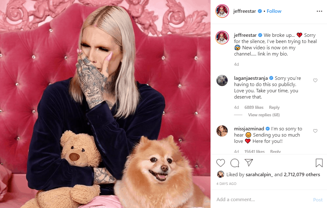 Jeffree Star crying in pink bed with his dogs around him as he promotes new YouTube video